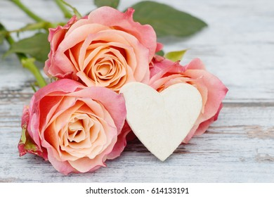 roses with white heart on wood