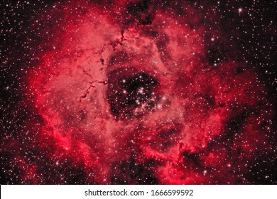 Rosette Nebula or Caldwell 49 is a large spherical H II region. it is circular in appearance and located near one end of a giant molecular cloud in the Monoceros region of the Milky Way Galaxy.
