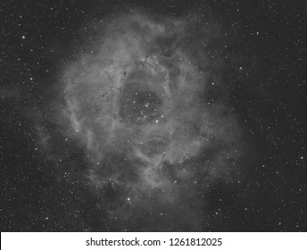 Rosette Nebula with hydrogen emmission, taken by telescope and special filter, with also many stars as background.