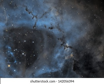 The Rosette Nebula is a large, circular hydrogen region located near one end of a giant molecular cloud in the Monoceros region of the Milky Way Galaxy.
