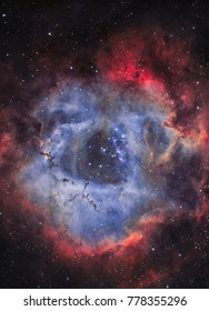 The Rosette Nebula, a large spherical region in the constellation Monoceros (NGC 2244 in narrow band light)
