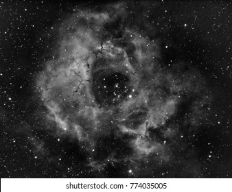 Rosette Nebula or also NGC 2237 with hydrogen alpha filter, taken by telescope in the dark deep space with also many star as background.