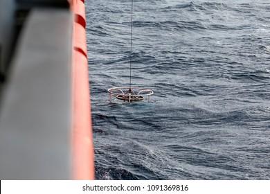 Rosette sampler being deployed from a ship