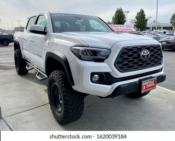 Roseville, CA - January 15, 2020: White Toyota Tacoma pick up truck 2020 year model on a dealership lot.