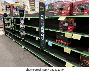 ROSEVILLE, CA - JANUARY 7, 2018: Graphics card shelves at an electronics store picked clean by cryptocurrency miners. Miners target nVidia GeForce GPUs for their mining efficiency.