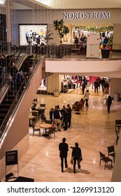 ROSEVILLE, CA/U.S.A. - DECEMBER 20, 2018: A photo of the Nordstrom's store and escalator with unidentified shoppers.