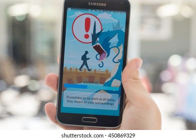 Roseville, CA/USA - July 11: An Android user reads the warning screen for the new Pokemon Go app that was released on July 6, 2016. It is an augmented reality mobile game for smart phones by Niantic