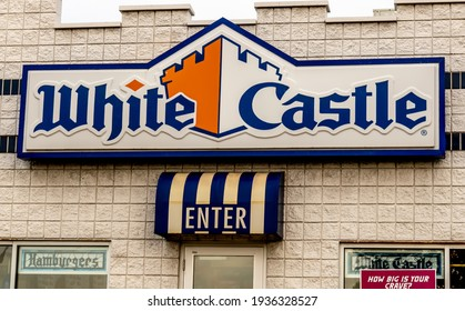 """Roseville, MI USA - 09 22 2020:  Medium, horizontal shot of exterior facade of """"White Castle"""" fast food restaurant, showing brand and logo signs on two sides of building."""