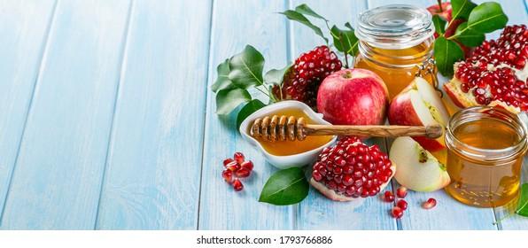Rosh hashanah concept - honey, apples, pomegranate, symbols copy space
