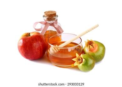 rosh hashanah (jewesh holiday) concept - honey, apple and pomegranate isolated on white. traditional holiday symbols.
