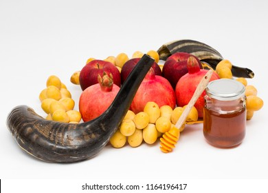 Rosh hashanah (jewish New Year holiday) concept signs: honey jar, honey dipper, shofar (horn), pomegranates,  apples, yellow dates. Traditional symbols of jewish holiday culture  on a white background