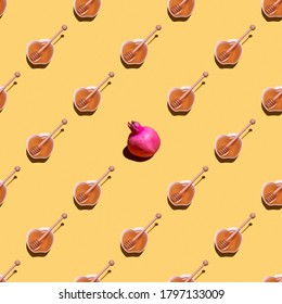 Rosh hashanah. Jewish New Year  seamless pattern with apple and pomegranate on yellow background. Minimal concept.