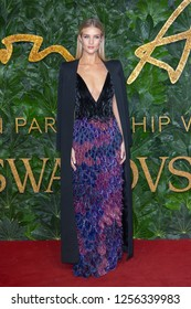 Rosie Huntington-Whiteley arrives at The Fashion Awards 2018 at the Royal Albert Hall on December 10, 2018 in London, England.