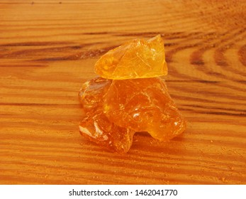rosin isolated on wooden background