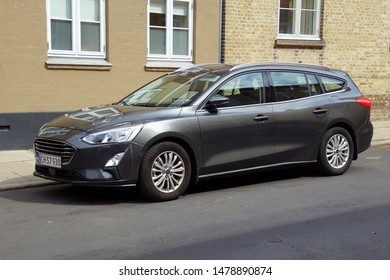 Roskilde, Denmark - July 19, 2019: Grey Ford Focus Station parked on a public parking lot. Nobody in the vehicle.