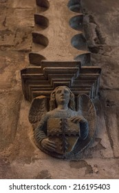 ROSLIN, SCOTLAND: AUGUST 5, 2014: Stone statue of angel holding shield with templar amblem in Rosslyn chapel, one of most popular tourist attraction in Scotland.