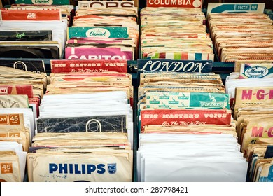 ROSMALEN, THE NETHERLANDS - MAY 10, 2015: Wooden boxes with vinyl turntable records on a flee market in Rosmalen, The Netherlands