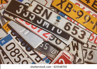 ROSMALEN, THE NETHERLANDS - MAY 8, 2016: Vintage European car license plates on a flee market in Rosmalen, The Netherlands
