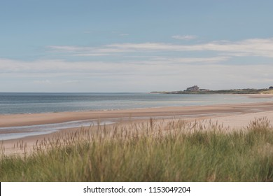 Ross Back Sands Beach in Northumberland looking towards Bamburgh Castle