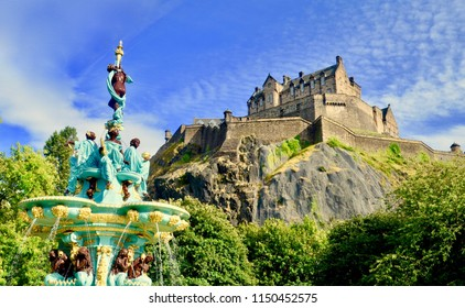 Ross Fountain with Edinburg Castle in the background. Popular tourist attractions viewed from Princes street gardens. Princes street, Edinburgh city centre, Scotland UK. jULY 2018