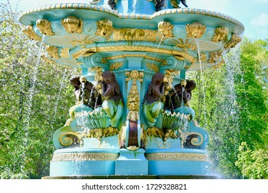 Ross water fountain, recently repainted and restored. Water fountain pouring over bronze statues. Edinburgh Princes streets gardens, scotland UK. may 2020
