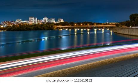 Rosslyn Skyline, Theodore Rosevelt Memorial Bridge and traffic trails on Ohio Drive, in Washington DC