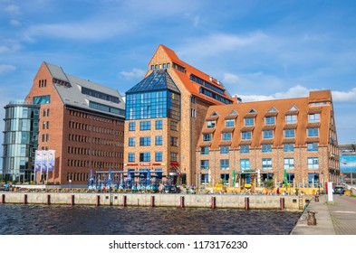 ROSTOCK, GERMANY - JUNE 14, 2011: View on Office buildings (Speicher) in the city harbor and River Warnow