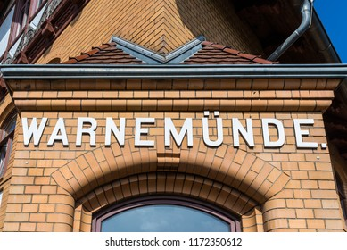 Rostock, Germany - May 26, 2017: Station name on the building of the Warnemunde Railway Station in Warnemunde, Rostock, Mecklenburg, Germany.