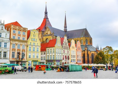 Rostock, Germany - October 22, 2017: New Market Square with unidentified people. It is one of the most picturesque places in Rostock, with the Town Hall that was originally built in the 13th century