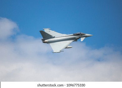 Rostock Laage, Germany - May 22, 2018: German air force Eurofighter Typhoon flying fast with agile movements in the sky with a full weapon load