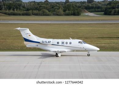 Rostock Laage, Germany - September 10 , 2018:  Embraer Phenom 100 Jet on the Airport Rostock Laage in germany - Embraer Phenom 100 Business Jet