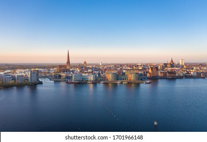 Rostock, Mecklenburg-Western Pomerania/Germany - April 7, 2020: Aerial view of the skyline of Rostock, view over the river warnow