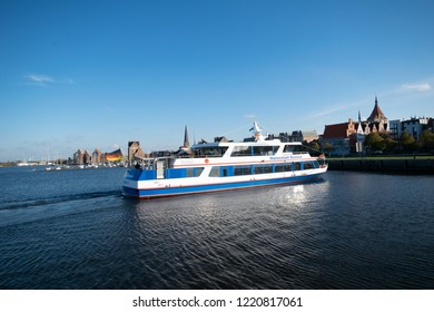 Rostock,Germany -31.Oktober,2018:Excursion ship arrives at the pier kai in the background St. Mary's Church