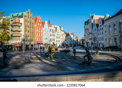 Rostock,Germany -31.Oktober,2018:Fountain of the joie de vivre Rostock on the university square with a view of facades in the Kröpeliner street