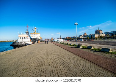 Rostock,Germany -31.Oktober,2018:On the banks of the Warnow with icebreaker Stephan Jantzen in the city harbor with a view of the city