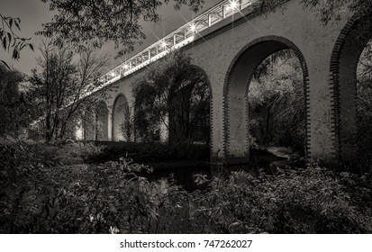 Rostokino Aqueduct at night, also known as Millionny Bridge, is a stone aqueduct over Yauza river in Rostokino District of Moscow, Russia, built in 1780-1804.