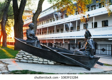 Rostov on Don, Russia - April 30, 2018: Sculpture ''Gregory and Aksinya in a boat'' on embankment in city  depicts heroes of novel by Sholokhov ''And Quiet Flows the Don or Quietly Flows the Don''