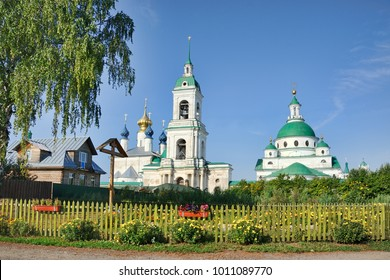 ROSTOV, RUSSIA - Spaso-Yakovlevsky Monastery Framed by Trees in Summer Morning. View from a guest house on Dobrolubova street. Summer cityscapes of ancient Rostov Velikiy (The Great).