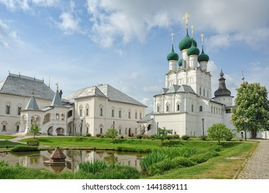 ROSTOV VELIKIY - Red Chamber and Church of St. John of Rostov Kremlin. View from a path near a small well-maintained pond on architectural ensemble of the 17th century buildings