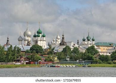 "ROSTOV VELIKIY, RUSSIA - Floating pier ""Podozerka"" (Eng: At the Lake) with docked boats in the background of the beautiful onion-shaped cupolas (domes) of Rostov Kremlin. View from a pleasure boat."
