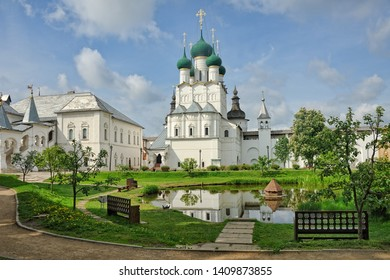 ROSTOV VELIKIY (THE GREAT), RUSSIA - Pond with a wooden house for birds in the background of the tall Gate Church of St. John the Theologian and Red Chamber building in Rostov Kremlin. UNESCO Heritage