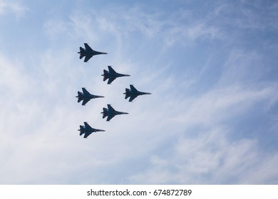 ROSTOV-NA-DONU, RUSSIA - MAY 21, 2015:RUSSIAN PILOTS ARE FLYING IN THE SKY  SU-27 FIGHTER, AT AN AIR SHOW, MILITARY PARADE.