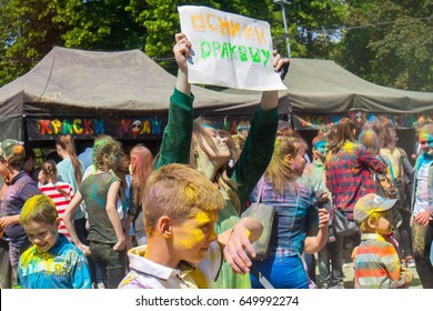 Rostov-na-Donu, RUSSIA - May 21,2017 : Festival of paints holi cheerful joyful people in colors of all bright colors guys, girls, crowd