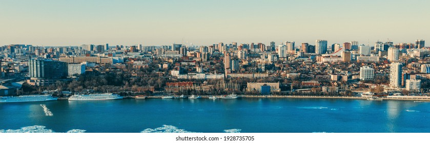 Rostov-on-Don city with Don river and many modern and historic buildings on right coast, aerial panorama