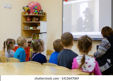 Rostov-on-Don, Russia, 29.10.2018 :room in kindergarten . Children look at the interactive whiteboard learn in the children's room