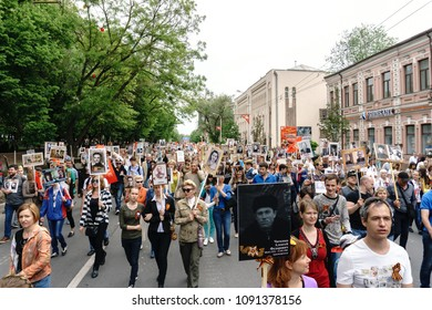 Rostov-on-Don / Russia - 9 May 2018: People in the procession of the Immortal Regiment carry portraits of the participants of World War II who are no longer alive as a sign of memory and sorrow