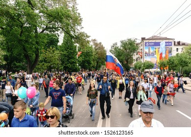 Rostov-on-Don / Russia - 9 May 2018: Thousands of people are walking along the central streets, carrying flags of Russia and the USSR and celebrating the Great Victory Day 1945