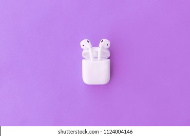 ROSTOV-ON-DON, RUSSIA - APRIL 28, 2018: Apple AirPods wireless Bluetooth headphones and charging case for  Apple iPhone. New Apple Earpods Airpods in box.