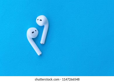 ROSTOV-ON-DON, RUSSIA - APRIL 28, 2018: Apple AirPods wireless Bluetooth headphones for  Apple iPhone. New Apple Earpods Airpods on a blue background. Copy space