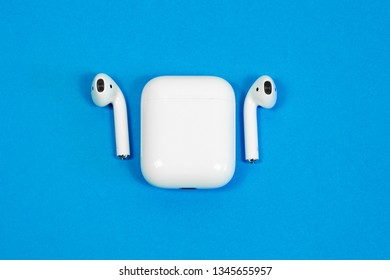 ROSTOV-ON-DON, RUSSIA - APRIL 28, 2018: Apple AirPods wireless Bluetooth headphones and charging case for  Apple iPhone. New Apple Earpods Airpods 2 in box.